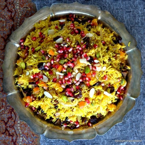 Top view of a serving bowl of Persian Jeweled Rice with pomegranates