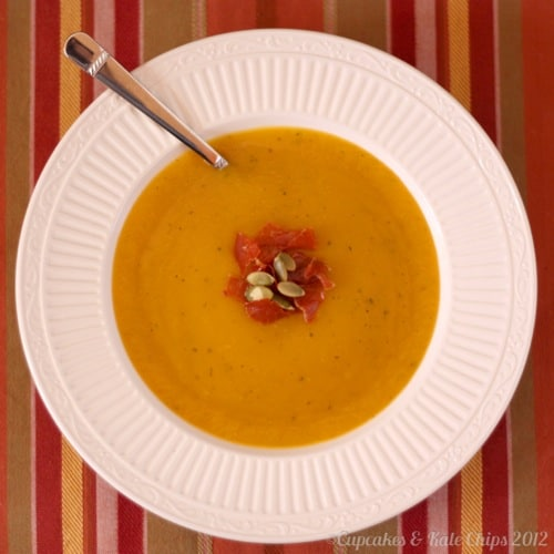 Top view of a bowl of Butternut Squash Soup garnished with pumpkin seeds