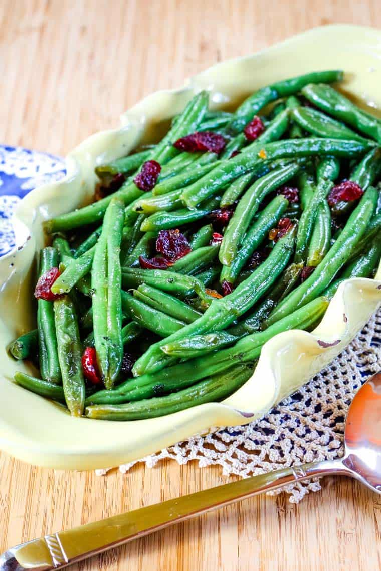 Orange Green Beans with Dried Cranberries in a serving dish