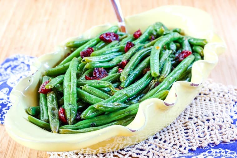 Glazed Fresh Green Beans in a yellow serving dish