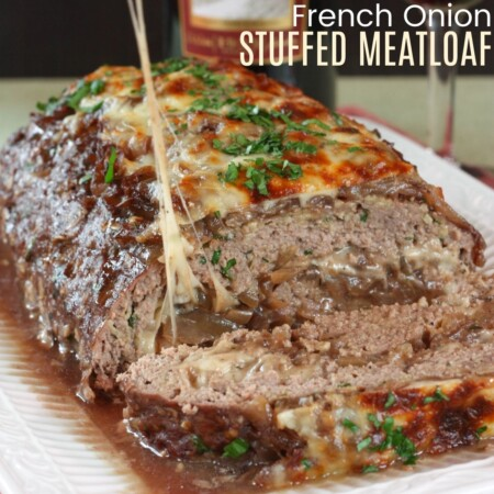 Onions and cheese oozing from inside a stuffed meatloaf