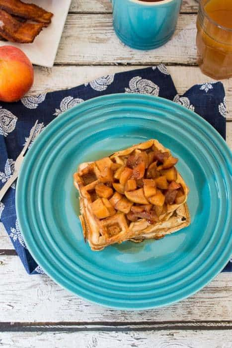 Apple Cider Waffles topped with the sautéed chopped apples are a hearty breakfast recipe or make-ahead brunch the family will love to wake up to | thegirlinthelittleredkitchen.com for cupcakesandkalechips.com