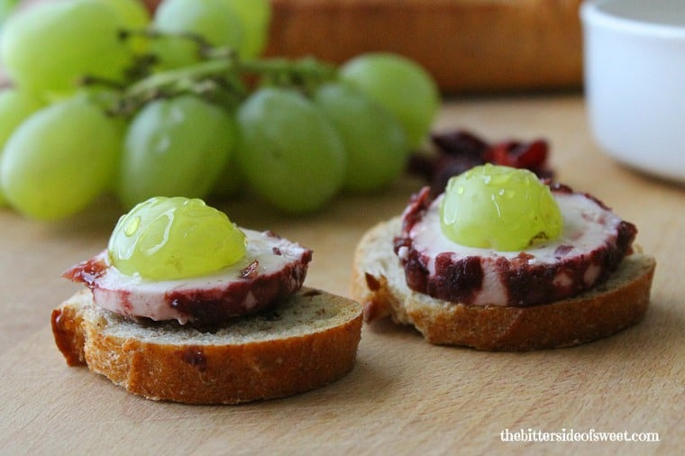 Cranberry Grape Goat Cheese Crostini on a cutting board