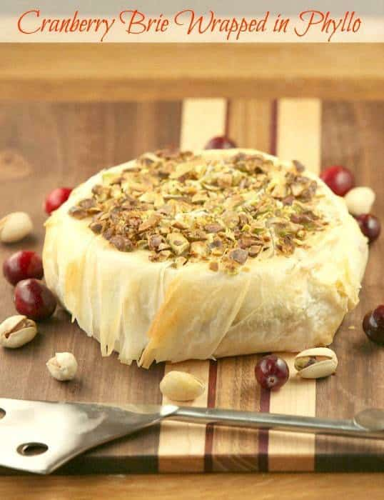Cranberry Pistachio Stuffed Brie Wrapped in Phyllo - pin it to your Appetizer Board, because every party needs ooey gooey cheese! | fooddonelight.com for cupcakesandkalechips.com