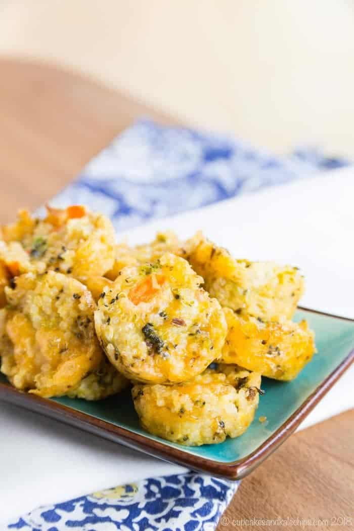 Cheesy Quinoa Vegetable Snacks for kids on a small rectangle plate