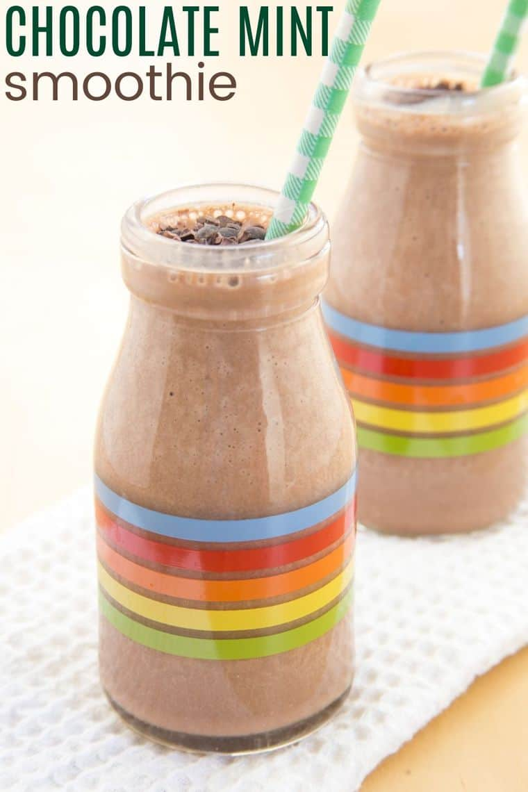 Chocolate Mint Smoothie in a glass bottle with multicolored striped and a green and white straw