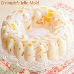 "Creamsicle Jello Mold - cubes of fresh orange jello ""floating"" in vanilla ice cream gelatin for a fresh and creamy, fun retro dessert! 