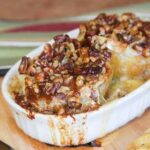 Melted brie cheese and honey nut topping oozes over baked bloomin' apples