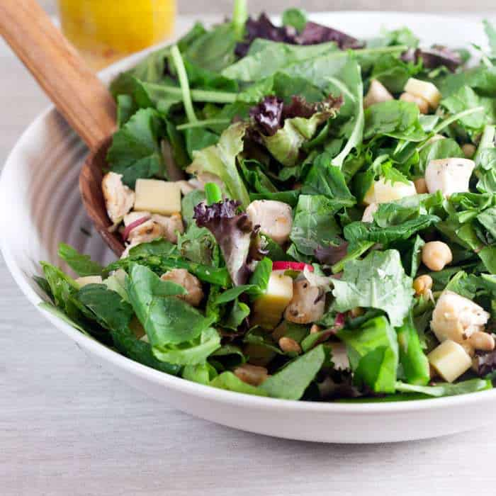 Farmhouse Salad with Citrus Vinaigrette - a satisfying dinner salad with spring vegetables, chicken, chickpeas, and sharp cheddar cheese. | cupcakesandkalechips.com
