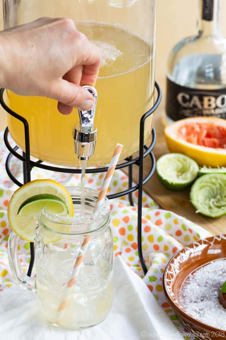Filling a glass from a pitcher of Skinny Grapefruit Margaritas