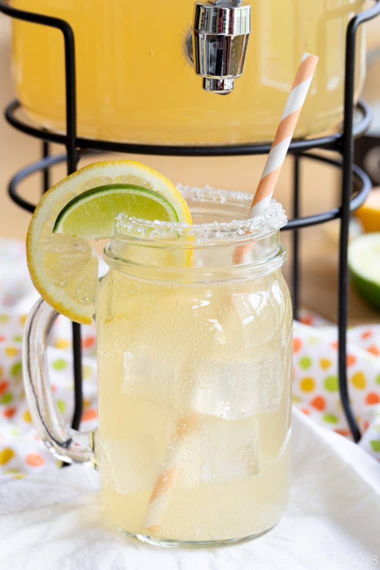 Low Calorie Grapefruit Margarita in a jar with coarse sugar on the rim