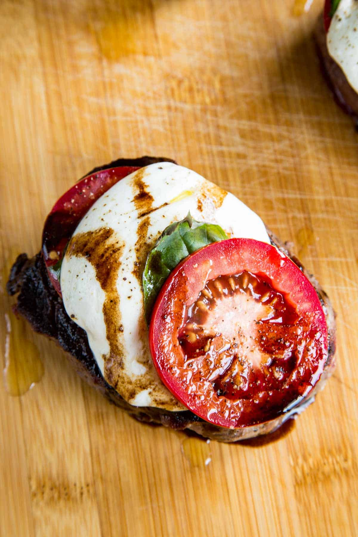 grilled filet steak with caprese salad topping