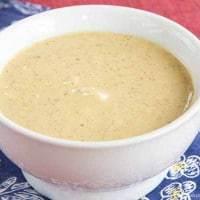 Small white bowl of honey mustard