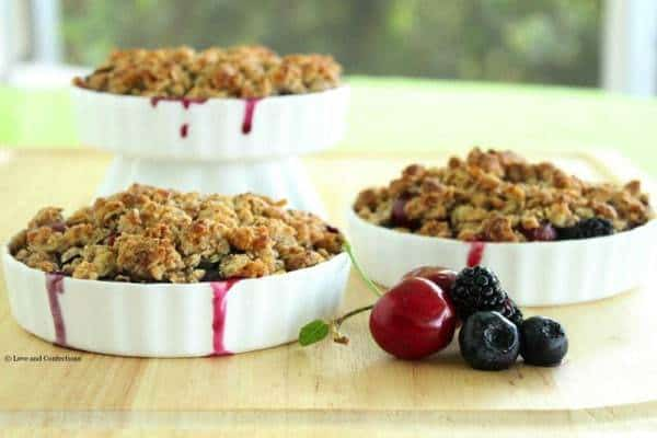 Gluten Free Blackberry, Blueberry and Cherry Crisp - Farmer's market fresh fruits combine with a crunchy almond and oat crumb topping to make an easy Summer dessert | loveandconfections.com for cupcakesandkalechips.com