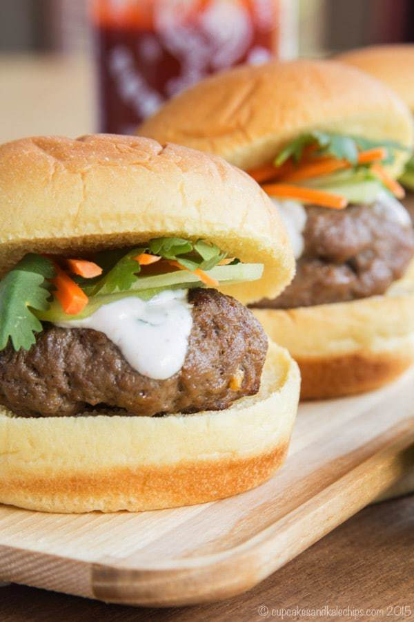 Closeup of a Mini Asian Burger with Thai flavors and Sriracha Lime cream sauce on top