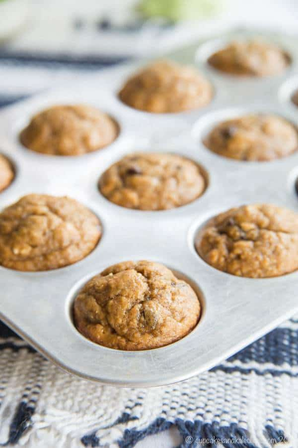 muffin pan full of gluten free peanut butter chocolate banana muffins