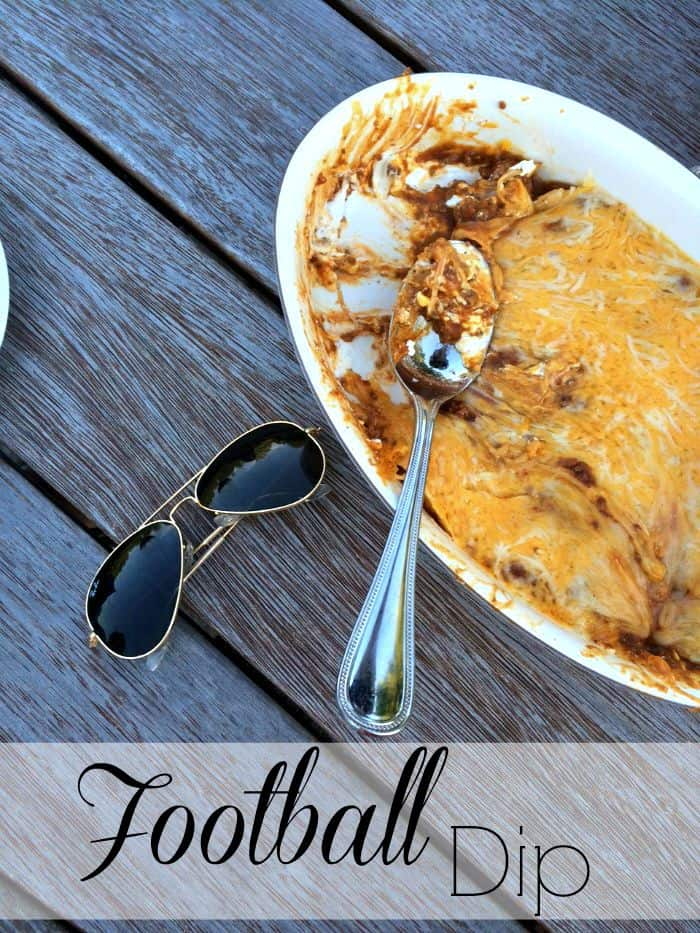 Football Dip in an oval serving dish topped with melted cheese