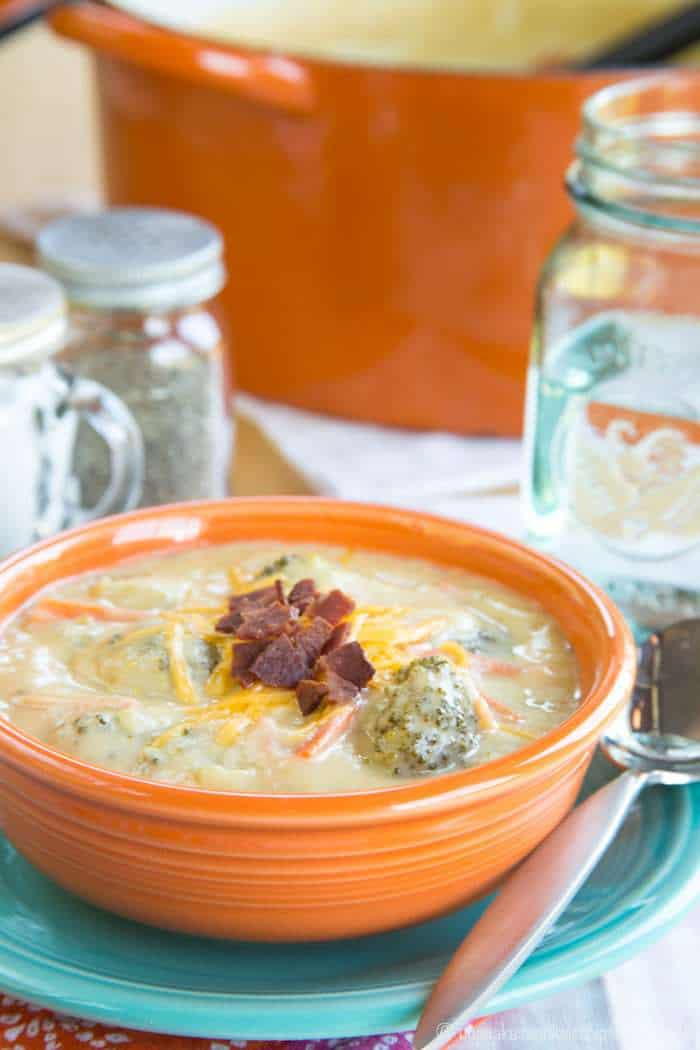 A bowl of low carb broccoli cheese soup topped with crumbled bacon