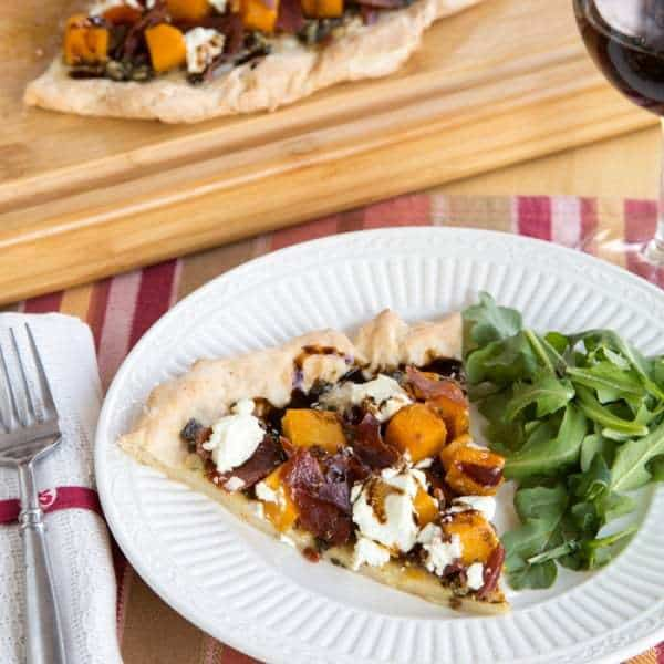 Roasted Butternut Squash, Prosciutto and Goat Cheese Pesto Pizza - use your favorite crust (even gluten free) and make this autumn-inspired pizza recipe with sweet, salty, tangy, and amazing flavors! | cupcakesandkalechips.com