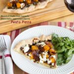 This slice of butternut squash pizza is topped with goat cheese, prosciutto, and pesto and pairs perfectly with a green salad.