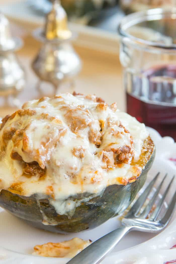 Lasagna Stuffed Squash filled with ricotta cheese and topped with Italian bolognese sauce and mozzarella cheese