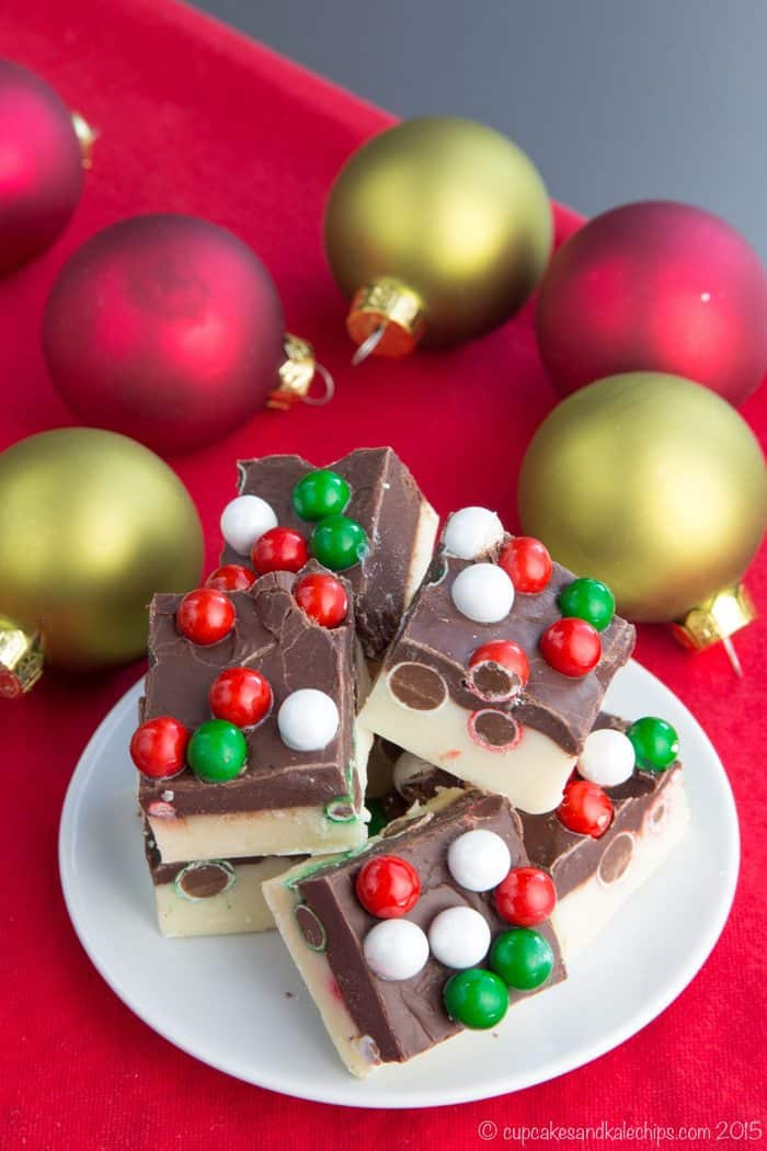 Double Chocolate Christmas Fudge with Sixlets on a plate surrounded by ornaments
