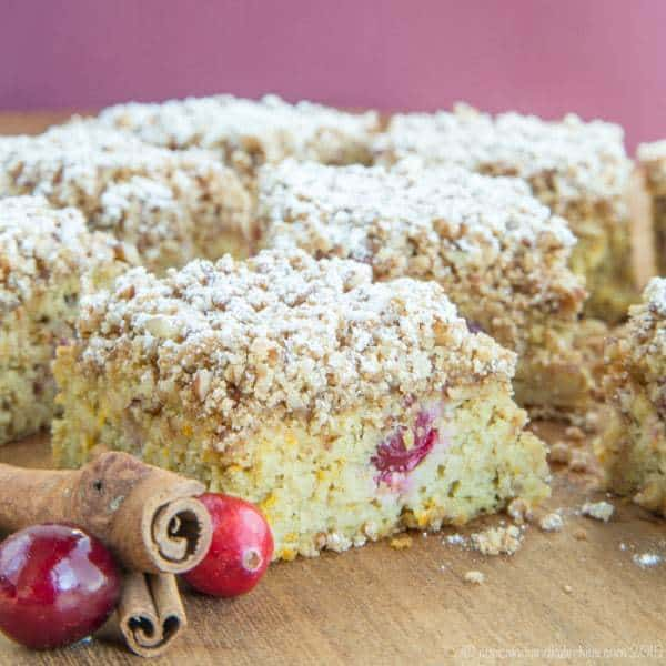 Gluten Free Cranberry Orange Coffee Cake - A moist and tender crumb cake with sweet and tart flavors perfect with a cup of coffee or tea for breakfast or dessert. | cupcakesandkalechips.com