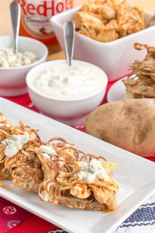 Buffalo Chicken Poutine on Potato Waffles - a fun and spicy version of the usual loaded French fries is great for dinner or snacking during the big game! | cupcakesandkalechips.com