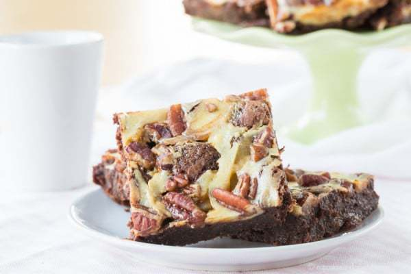 Flourless Turtle Cheesecake Brownies - a gluten free brownie recipe with caramel, chocolate, and pecans for a decadent dessert!