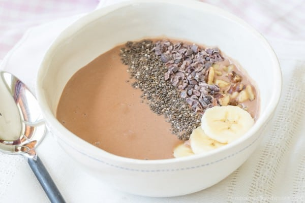 Banana Chocolate Chunk Smoothie Bowl - packed with protein and superfoods, this easy recipe is perfect breakfast, snack, or dessert. Gluten free and dairy free when made with @lovemysilk. #TastetheGoodness #ad   cupcakesandkalechips.com