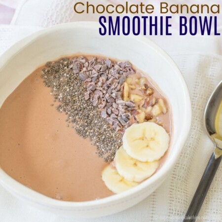 Smoothie bowl with bananas, chia seeds, walnuts, and cacao nibs on top