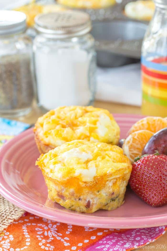 Make Ahead Breakfast Egg Muffins with Broccoli, Ham and Cheese on a pink plate