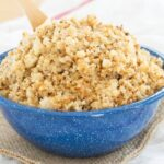 Cauliflower rice side dish recipe in a blue serving bowl