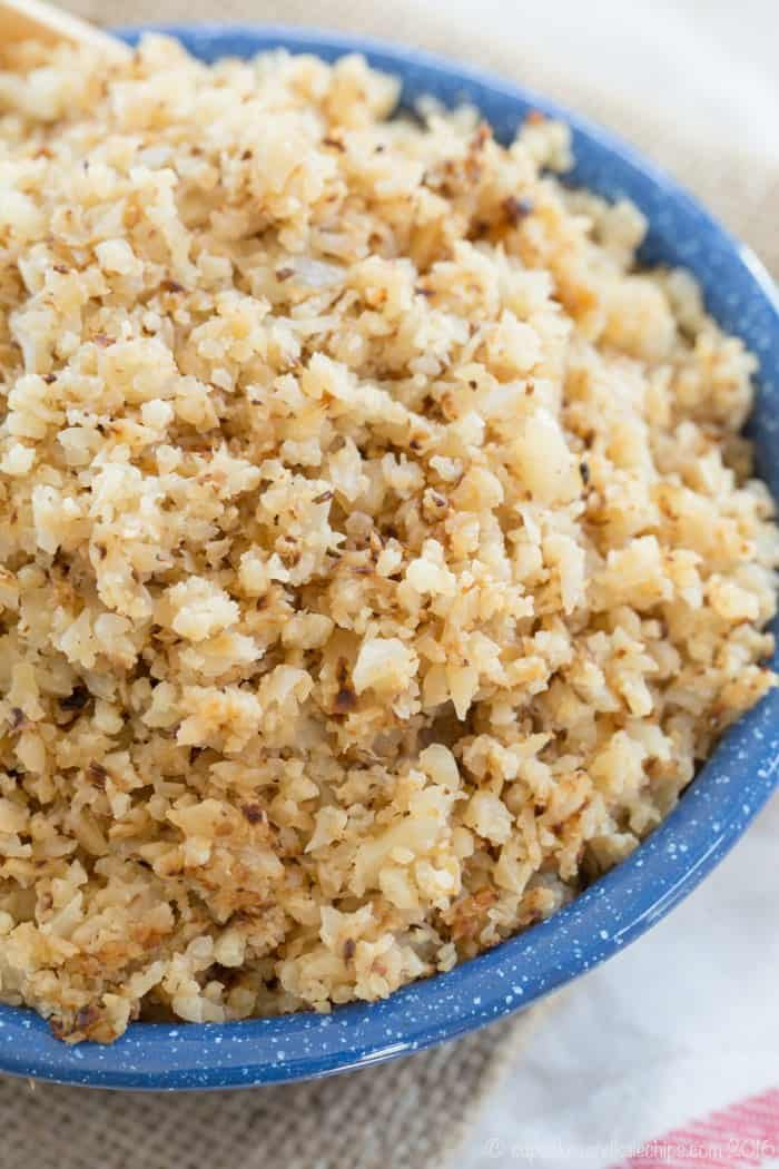 Closeup of Buttery Riced Cauliflower in a blue bowl