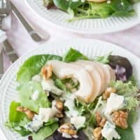 Two side salads with poached pears and blue cheese