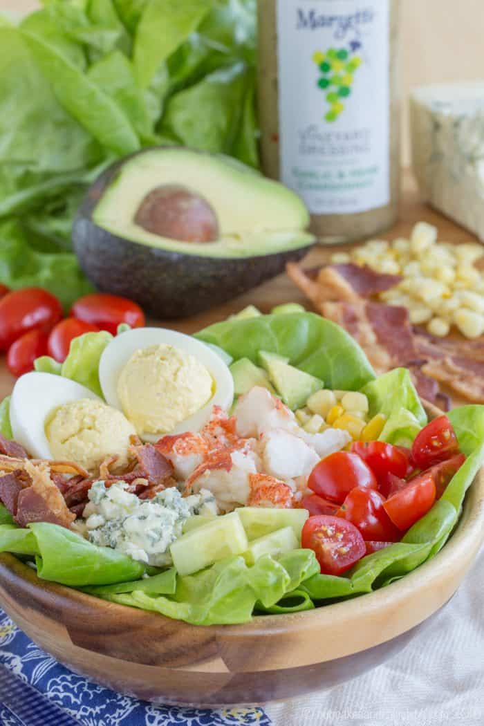 Cobb Salad with Lobster plus deviled eggs, bacon, blue cheese, avocado, corn, and tomatoes