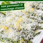 grilled asparagus on a platter covered in finely shredded cheese and lemon zest