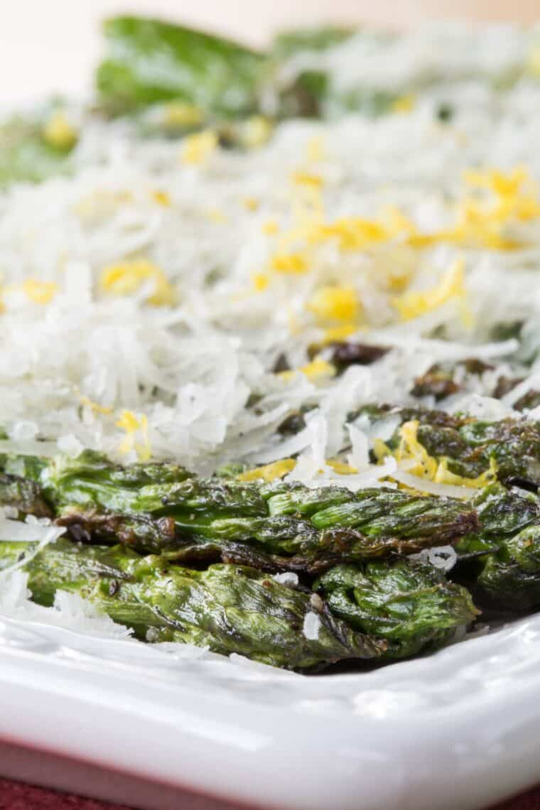 tips of grill asparagus spears with a coating of manchego cheese
