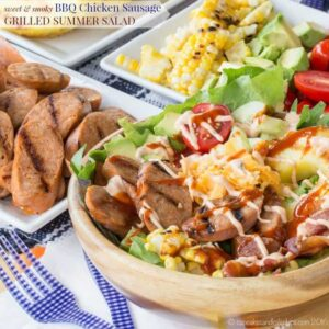 This grilled chicken sausage salad is topped with avocado, cheese, tomatoes, and corn.