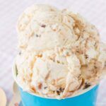 No-Churn Caramel Toffee Chip Cheesecake Ice Cream in a paper bowl