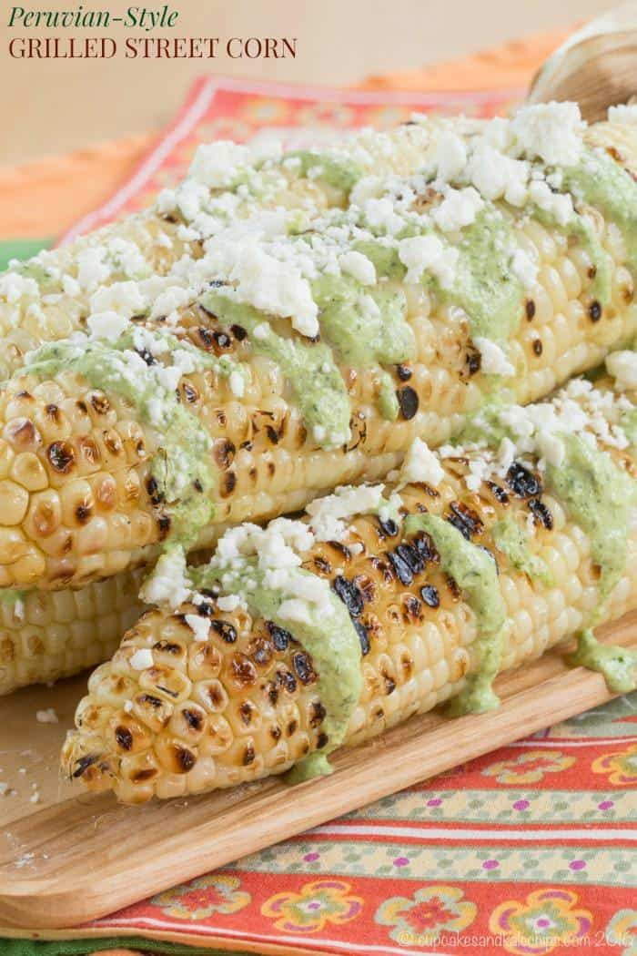 Peruvian-Style Grilled Street Corn - corn on the cob slathered with fresh and spicy Aji sauce and cheese is an easy summer side dish recipe! Gluten free | cupcakesandkalechips.com