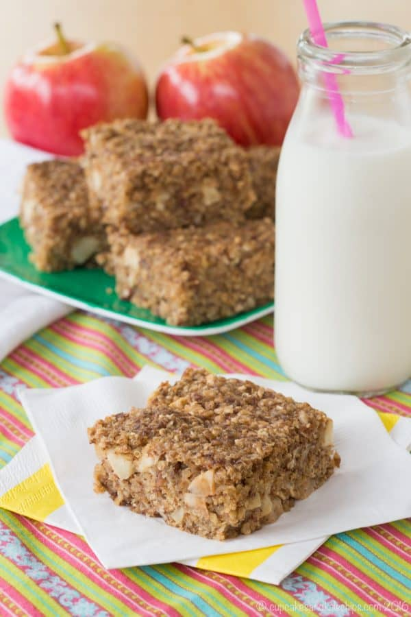 Cinnamon Apple Quinoa Breakfast Bar on a napkin with a glass of milk