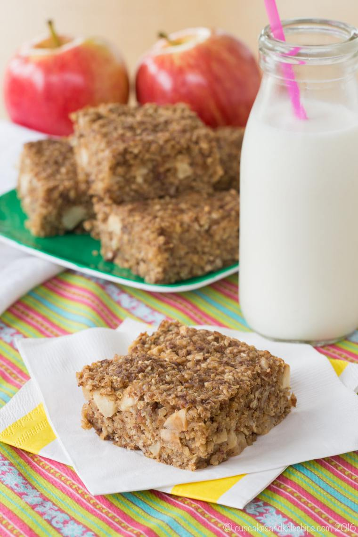 Cinnamon Apple Quinoa Breakfast Bar on a napkin with a glass of milk