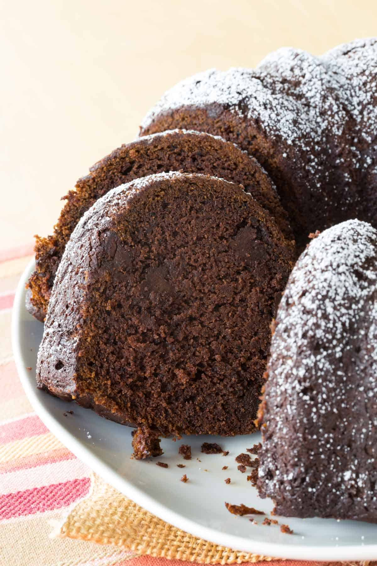 Sliced gluten free bundt cake on a platter