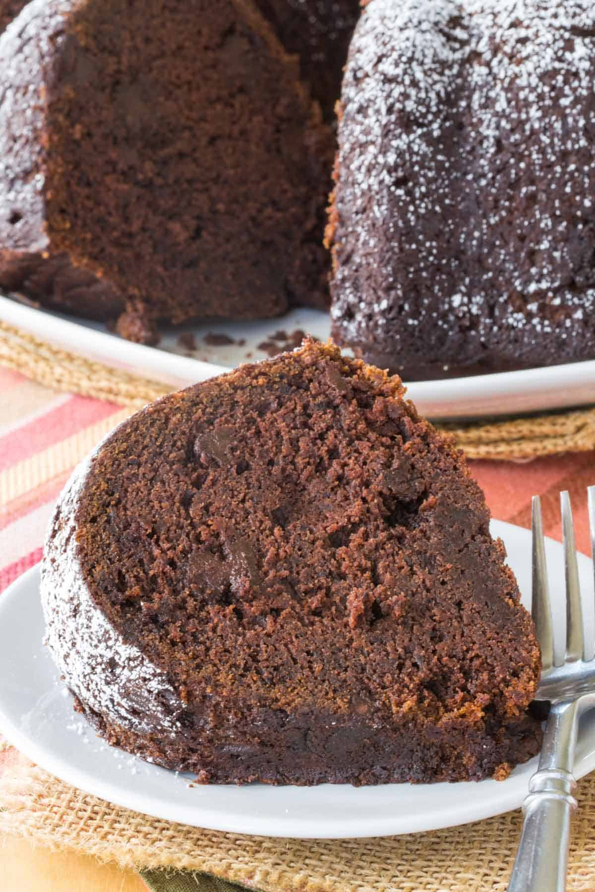 A big slice of moist Gluten Free Chocolate Pumpkin Spice Bundt Cake
