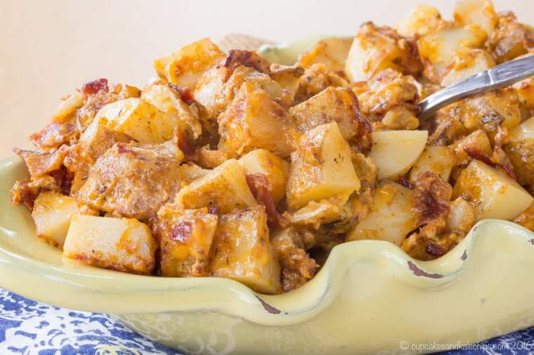 Cheesy roasted potatoes piled in a serving bowl