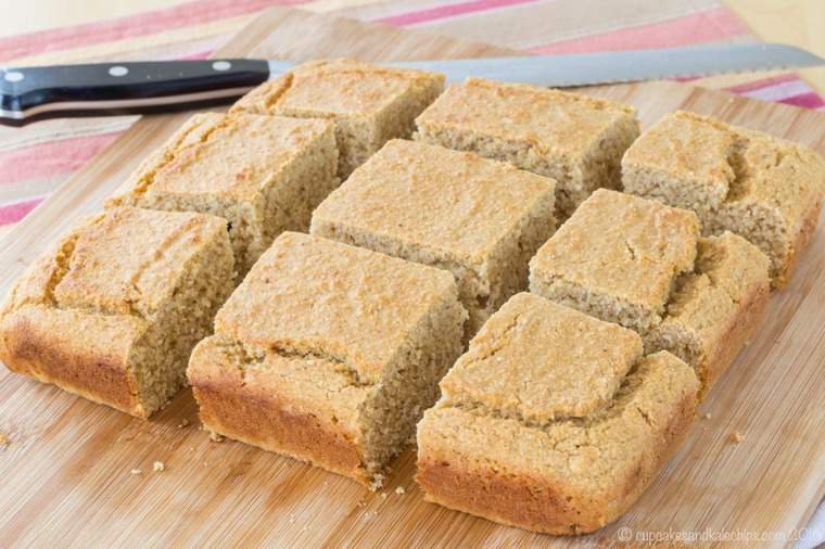 Apple Butter Gluten Free Cornbread sliced on a cutting board