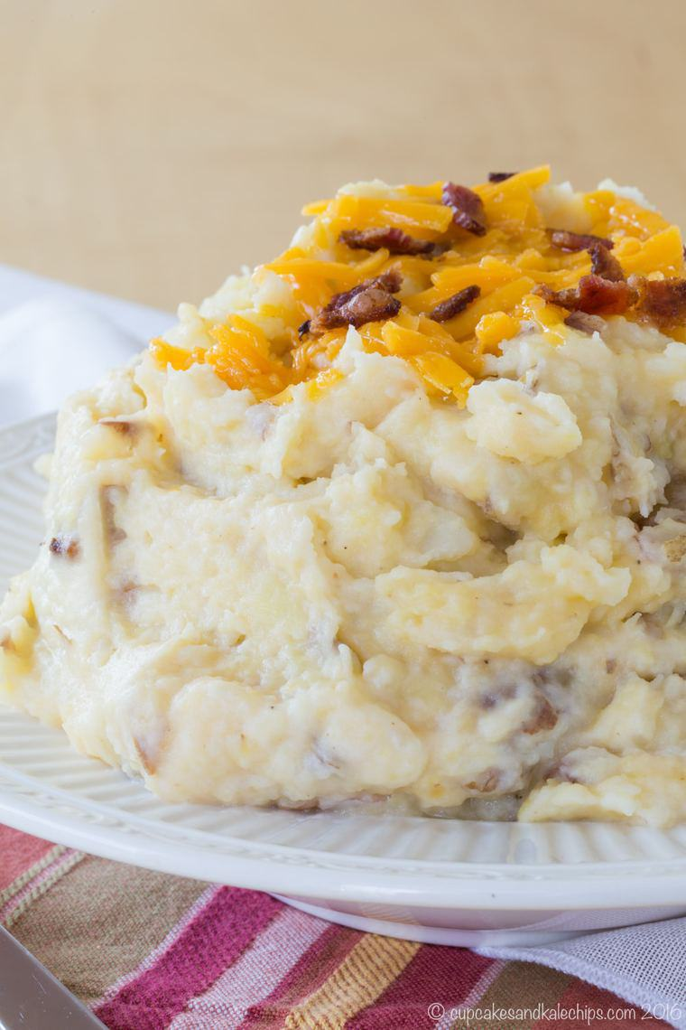 A heaping bowl of bacon cheddar cheese mashed potatoes with skin