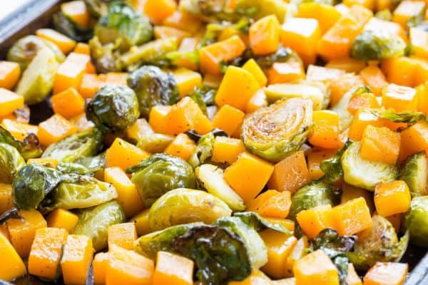 Maple Roasted Brussels Sprouts and Butternut Squash is a simple, four ingredient vegetable side dish recipe perfect for a weeknight dinner or a holiday meal. Gluten free, vegan, and paleo.