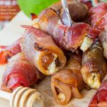Sweet and Spicy Blue Cheese Bacon Wrapped Dates coated in a honey lime sriracha glaze will be your new favorite gluten free party appetizer recipe!